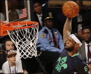 East Team's LeBron James, of the Miami Heat (6) heads to the hoop during the NBA All Star basketball game, Sunday.