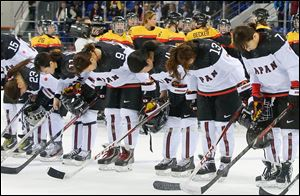 Members of team Japan bow after their 3-2 loss to Germany today in Sochi, Russia.