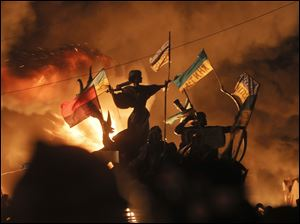 Monuments to Kiev's founders burn as anti-government protesters clash with riot police in Kiev's Independence Square, the epicenter of the country's current unrest,  Kiev, Ukraine, Tuesday.