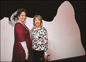 Left to right Susan Braun dressed as Molly Brown and Mary Arquette during the Titanic Exhibit preview reception.
