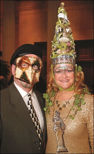 Tom and Kelly Sheehan during the Masquerade Garden Party.