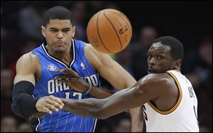 Orlando Magic's Tobias Harris, left, and Cleveland Cavaliers' Luol Deng watch the ball during the first quarter.