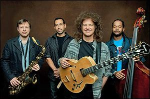 Pat Metheny, second from right, with Unity Band members Chris Potter, Antonio Sanchez, and Ben Williams.