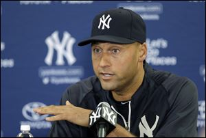 New York Yankees shortstop Derek Jeter gestures during a news conference today in Tampa, Fla. Jeter has announced he will retire at the end of the 2014 season.