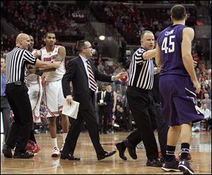 Referees and coaches separate Northwestern's Nikola Cerina, right, and Ohio State's LaQuinton Ross during a second-half scuffle on Wednesday. Cerina and Ross were both ejected from the game.