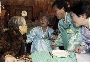 South Korean Kim Sung-yoon, 96, left, talks with her North Korean family members during the Separated Family Reunion Meeting at Diamond Mountain resort in North Korea, today.