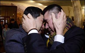 South Korean Park Yang-gon, left, and his North Korean brother Park Yang Soo get emotional as they met during the Separated Family Reunion Meeting today.
