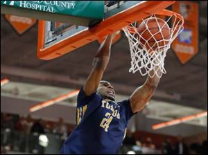 University of Toledo forward J.D. Weatherspoon (24) dunks the ball against  Bowling Green State University.
