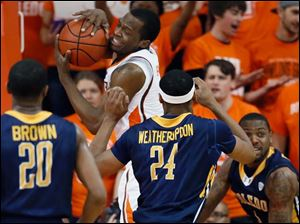 BGSU forward Spencer Parker (3) pulls in a rebound against Toledo defenders Julius Brown (20), J. D. Weatherspoon (24) and Rian Pearson (5).