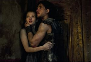 Emily Browning, left, and Kit Harington in a scene from 'Pompeii.'
