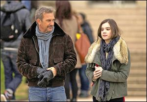 Kevin Costner, left, and Hailee Steinfeld in a scene from '3 Days to Kill.'