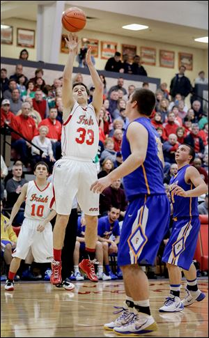 Central's Tom Vetter knocks down a 3-pointer while Findlay's Austin Gutting, foreground, looks on in Friday's matchup.