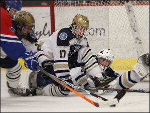 St. John's Jesuit's goalie senior Mike Barrett (29) keeps his eyes on the puck as his teammates senior Dominic Horrath (21) and senior Ben Hamilton (17) battle St. Francis de Sales' junior Ricky Kwapich (9) during the second period.