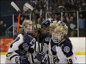 St. John's Jesuit celebrate junior Ian Rapp's, left, goal during the first period.