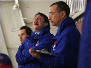 St. Francis de Sales' head coach Chris Varga, center, calls out directions to a player during the second period.
