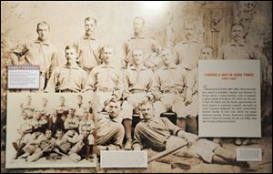 A mention of Moses Fleetwood Walker (back row, center) was included in a timeline in this photo at the National Baseball Hall of Fame in Cooperstown, N.Y., but it is dwarfed by Jackie Robinson's tributes.