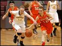Northview's Maddie Cole and Southview's Maria Pappas chase a loose ball.