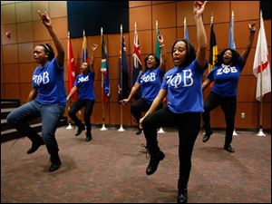 The University of Toledo Phi Beta Sigma performs a step routine at the Toledo-Lucas County Public Library.