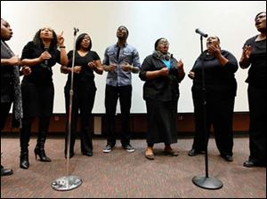 The music group Ushering performs during an event celebrating  the 50th Anniversary of the Passage of the Civil Rights Act of 1964 Saturday at the Toledo-Lucas County Main Library.