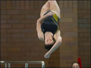 Taylor Willson of Notre Dame Academy spins toward the water.