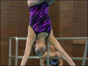 Anna Campos of Waite High School dives during the Ohio High School Div. I Diving Championships in Canton.