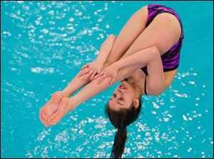 Anna Campos of Waite High School dives during the Ohio High School Div. I Diving Championships.
