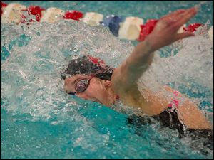 Emmy Sehmann of Bowling Green High School swims the 100-yard Freestyle. Sehmann placed seventh in the event with a time of 51.64.
