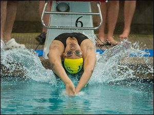 Zhada Fields of St. Ursula Academy begins the 100-yard Backstroke. Fields placed fourth in the event.