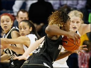 The Rockets' Sophie Reecher defends Western Michigan's Miracle Woods. At left, UT's Inma Zanoguera defends Marquisha Harris.