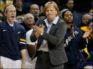 Toledo coach Tricia Cullop applauds a play.