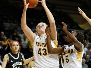 The ball slips through the hands of Toledo's Sophie Reecher after she and Janelle Reed-Lewis seek an offensive rebound during the game's final seconds.