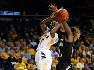 Toledo's Andola Dortch shoots while defended by Western Michigan's Miracle Woods.
