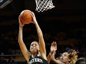 Western Michigan's Jessica Jessing grabs a defensive rebound. Jessing is a graduate of Northview High School.
