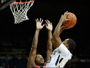 Toledo's Julius Brown shoots in front of Ball State's Bo Calhoun.