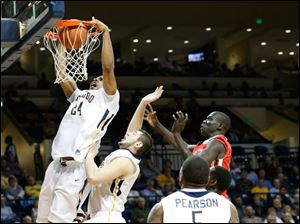 The Rockets' J.D. Weatherspoon dunks after an offensive rebound.