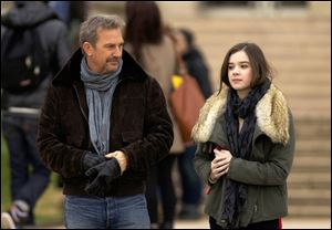 "Kevin Costner, left, and Hailee Steinfeld in a scene from ""3 Days to Kill."""