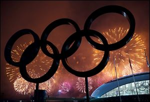 The Olympic Rings are silhouetted as fireworks light up the sky during the closing ceremonies at the 2014 Sochi Winter Olympics on Sunday in Russia.