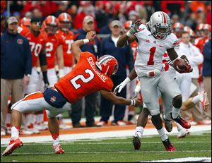 Ohio State cornerback Bradley Roby avoids Illinois quarterback Nathan Scheelhaase as he returns an interception a 63 yards for a touchdown during a Nov. 16, 2013, game in Champaign, Ill.