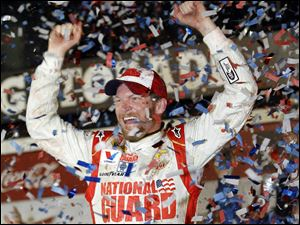Dale Earnhardt, Jr., celebrates in Victory Lane after winning the Daytona 500 at Daytona International Speedway on Sunday. It was his second victory in NASCAR's most famous race. He endured a rain delay of more than six hours.