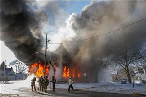 Toledo firefighters battled a blaze at St. Mark Baptist Church on N. Detroit Avenue in Toledo on Jan. 3. The evidence needed to determine the cause of a fire can be burned up, making an investigation difficult.
