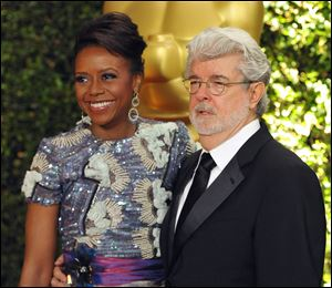 Filmmaker George Lucas and his wife Mellody Hobson.