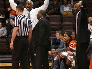 BGSU head coach Louis Orr, in white shirt, complains to a ref that his player had his hands up and did not foul.