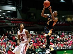 Toledo's Julius Brown shoots the ball in the first half.