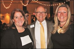 Leadership Toledo Executive Director Dave Schlaudecker stands between board members Becca Gorman, left, and Margot Estes, right, at Restaurant Week Toledo's kickoff party.