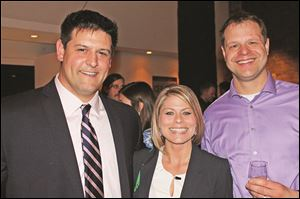 "From left, Andrew ""Bubba"" Berenzweig, of Hylant, an event sponsor, with Allison Hammons and Brad Augustiniak at the kick-off party for Restaurant Week Toledo."