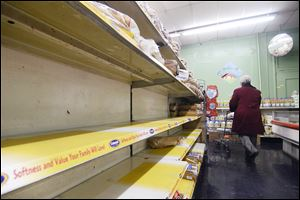 The bread shelves at Buehler's Market in Chattanooga, Tenn. are mostly empty. Owner Charles Morton says he has been in the business for 50 years, and the bread and milk sales have always increased in snow.