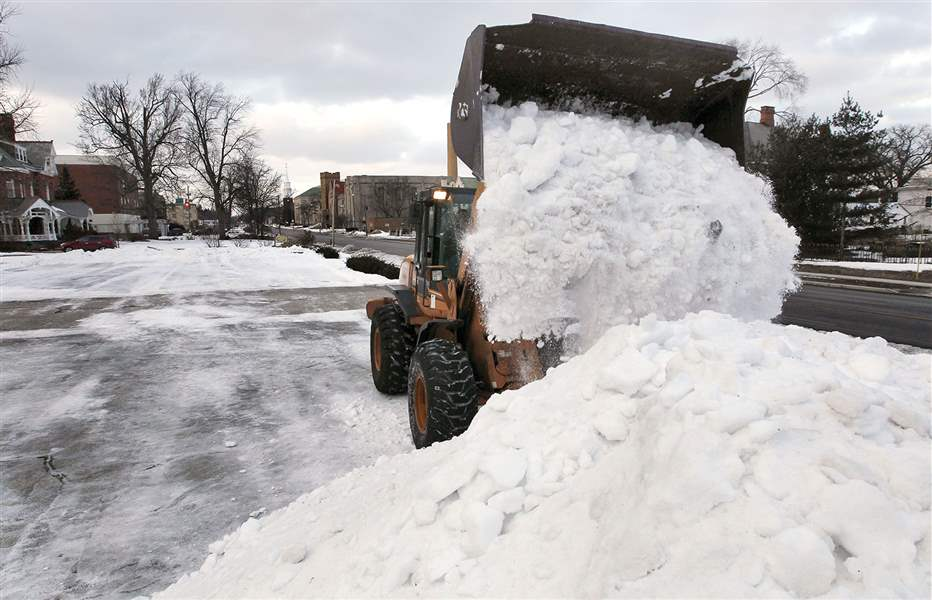 Paul-Voska-adds-to-an-ever-growing-pile-of-snow