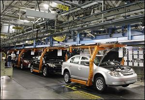 Chevrolet Cobalts move along the line at the Lordstown Assembly Plant in northeast Ohio.  The U.S. government's auto safety watchdog agency is looking into whether General Motors was slow to report problems with ignition switches that led to a massive recall after 13 deaths and 31 crashes.