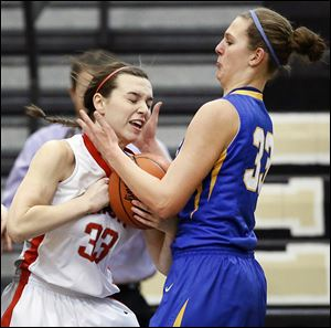 Clyde's Amanda Cahill, right, defends against   Central Catholic's Michelle Murnen. Cahill tallied 32 points and 13 rebounds.