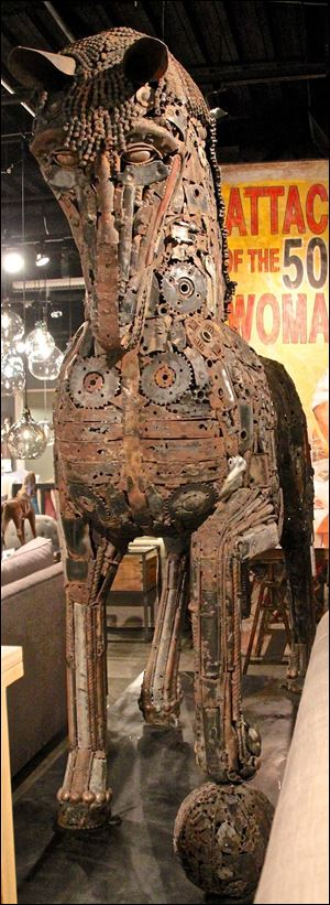Leonardo is a massive sculpture made of recycled motorcycle and car parts by Cisco Brothers.